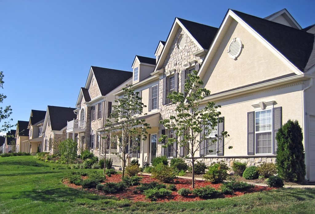 A row of upscale new houses in the suburbs.