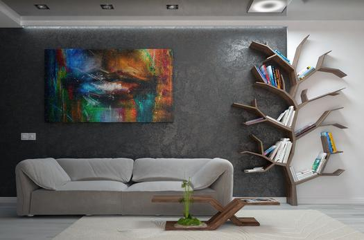 Modern living room with colorful art on gray wall, modern couch and table, and book shelf in the shape of a tree